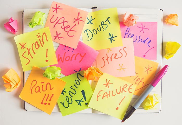 a personal or business diary covered in signs about stress and pressure