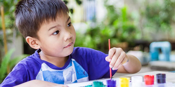 asian-child-boy-painting-and-coloring-in-the-class