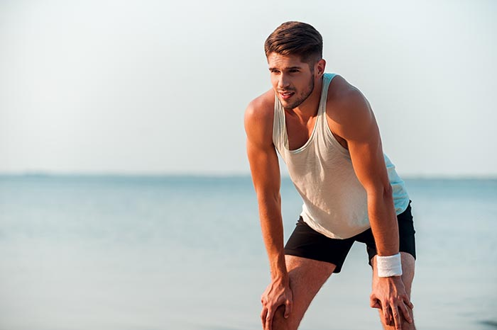 deep breathing while running along the beach using proper breathing exercises for performance