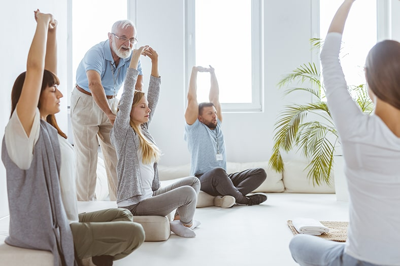 group-of-people-practicing-breathing-in-and-out-in-478-breathing-525-min