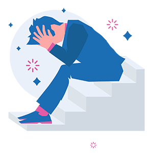 man sitting on stairs head burred in hands feeling stressed