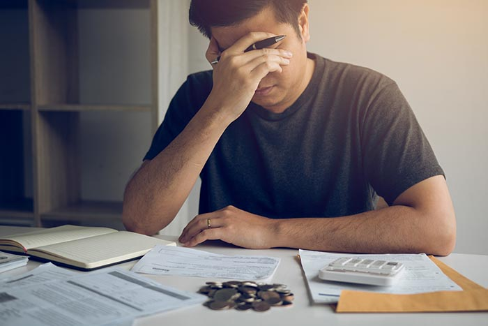 man stressed about financial problems needing stress management system as help