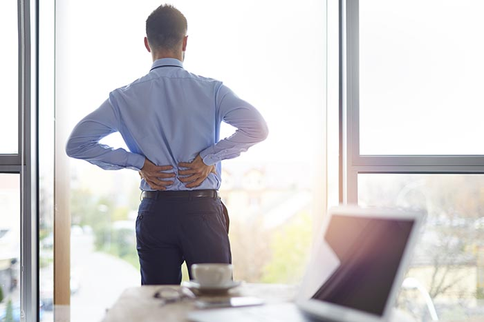 man-suffering-from-back-pain-700