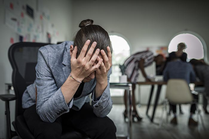 man-suffering-from-stress-and-anxiety-in-need-of-some-stress-management-700