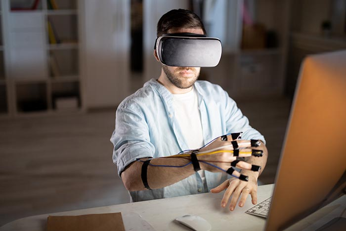 man-working-in-virtual-reality-settings-700