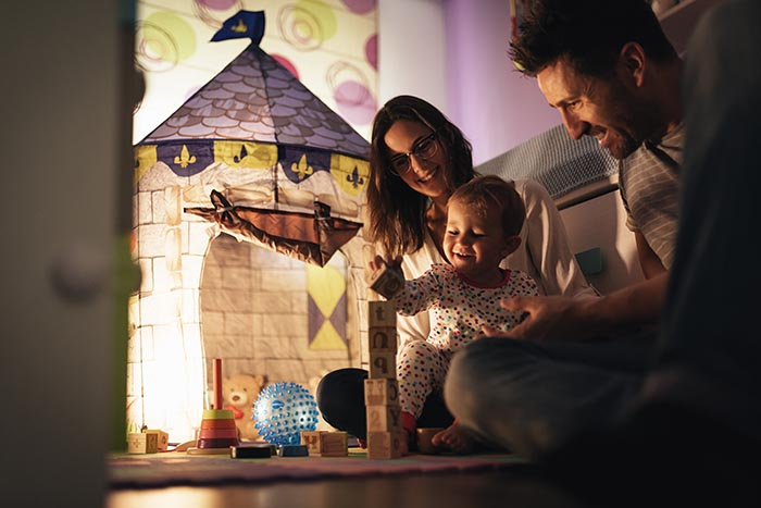 parents enjoying playing with their son at home