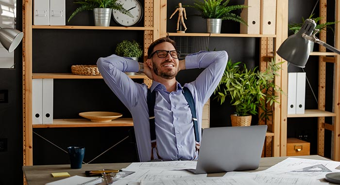 relaxed-happy-businessman-at-work-desk-cafe-table-2021-04-14-17-40-57-utc