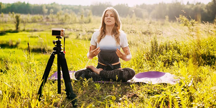 the-girl-practices-yoga-in-nature-and-records-a-vi-T544LHN