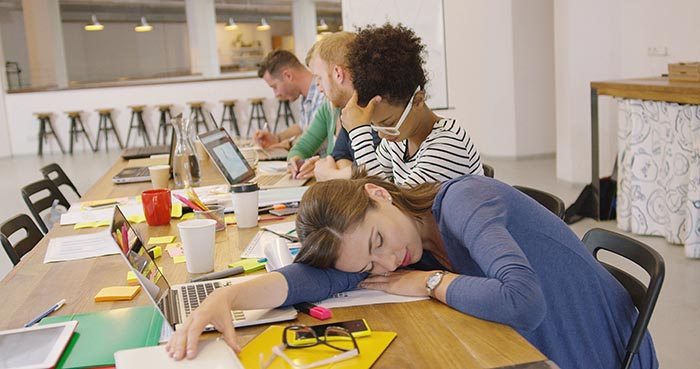 tired-worker-at-table-in-office-needing-help-with-stress-management-700