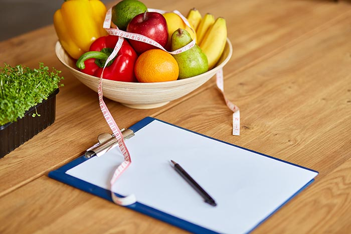 top-view-of-nutritionist-dietitian-workplace-with-goal-to-improve-workplace-wellness-700