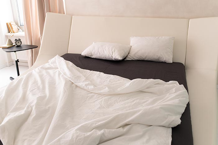 two-white-pillows-on-large-mattress-700