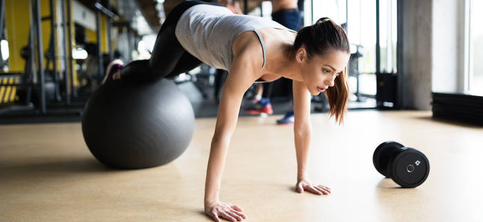 woman-in-plank-on-exercise-ball
