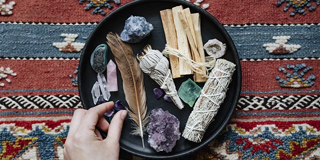 woman-with-sage-and-crystals-ready-for-smudging-UW38BUA