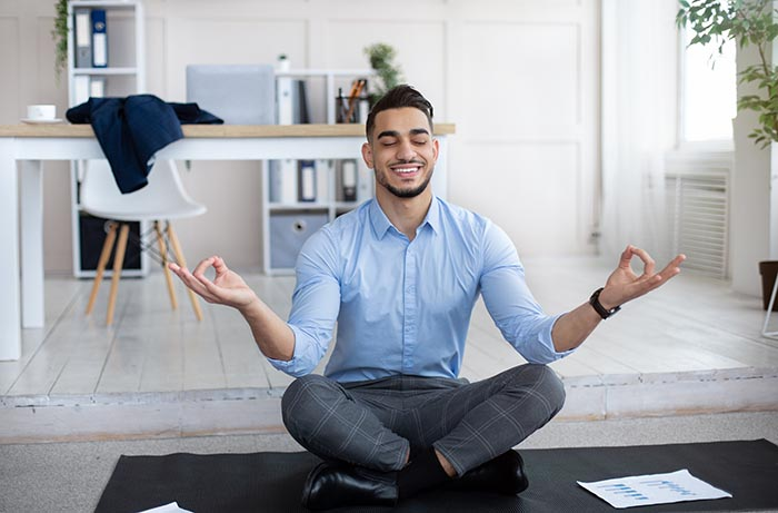 workplace stress management concept calm man practicing yoga