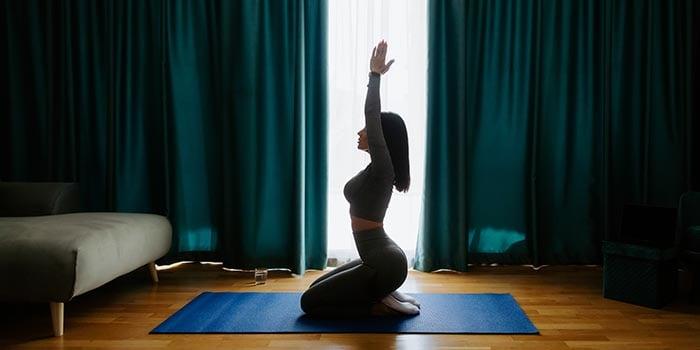 young-woman-practicing-yoga-at-home-meditation-pr-2021-04-14-08-34-55-utc