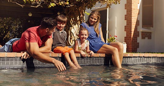 family relaxing their mind and body enjoying time together at the pool