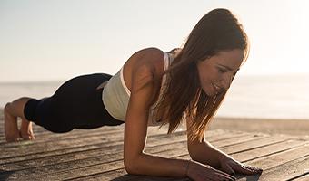 pilates vs yoga women doing pilates on the beach