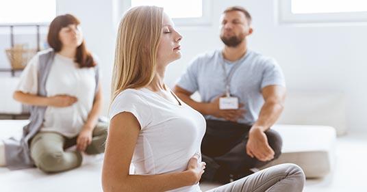 group of people practicing buteyko breathing
